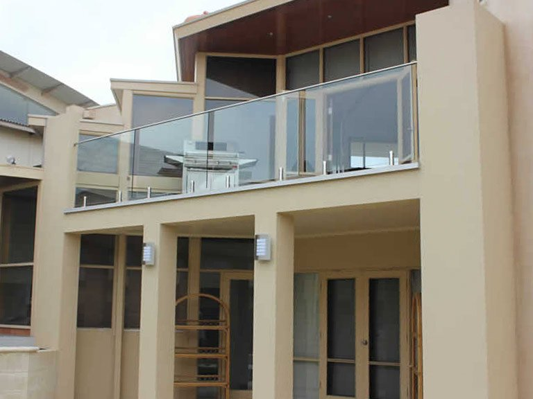 Balcony BBQ space with glass balustrade