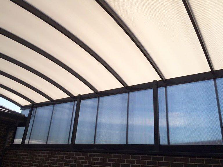 Architectural walls of different materials and curved roof