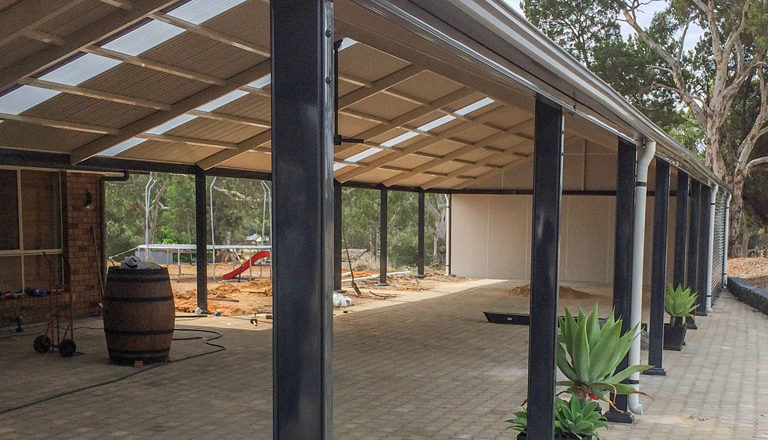 Large steel pergola with pitched roof for outback home