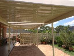 A home's steel back verandah with flat roof and garden
